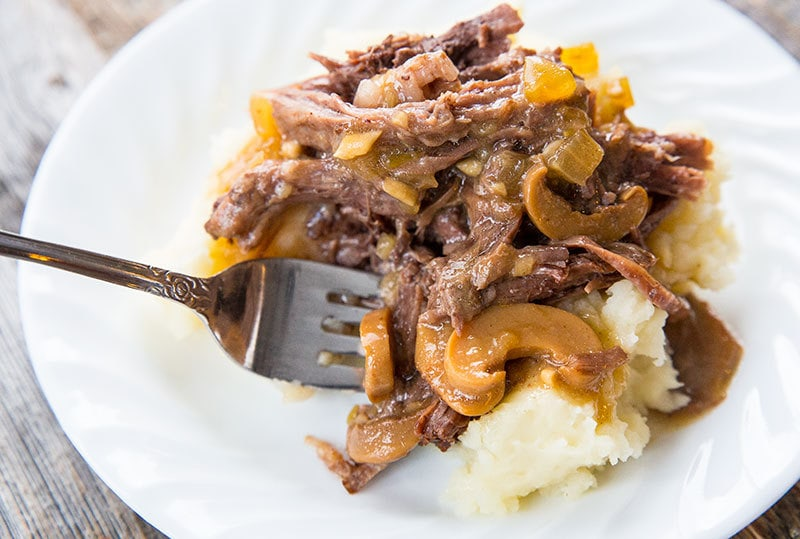 This Slow Cooker Pot Roast With Onion Mushroom Gravy is probably my favourite slow cooker pot roast of all time!