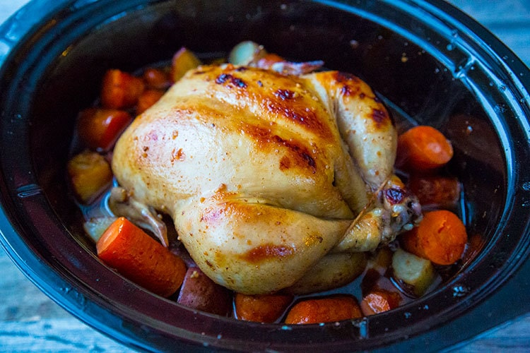 Delicious crockpot chicken with honey garlic sauce and vegetables!